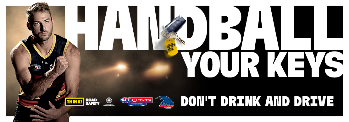 Large text saying 'Handball your keys' and 'Don't drink and drive' with a football player tossing a set of car keys.